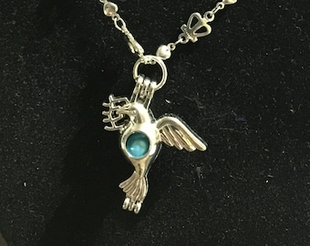 Bird with bright blue pearl fashion designed necklace