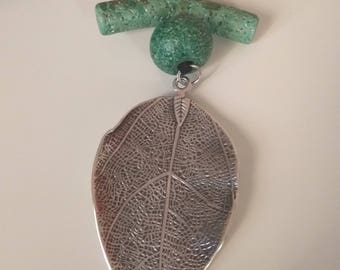 Necklace made by artificial suede cord, ceramic bead/bar and silver antique tone Leaf pendant