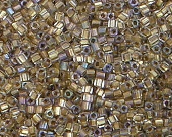 Toho 1.5mm Cube, Gold Lined Crystal (262), 10 grams