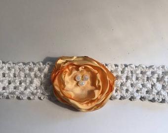 Sunshine yellow flower on a white headband.  Fits size 12 - 18 mths.