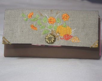 Purse long form made of synthetic leather and linen/cotton fabric Embroidered