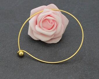 A Bangle bracelet in gold finish copper ball BA18 22 cm