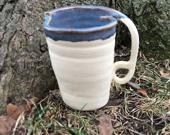 Beige and Blue Wheel thrown mug with cut handle