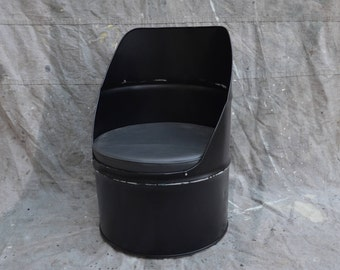 Industrial Furniture Barrel Chair Distressed Black w/ vinyl padded seat.