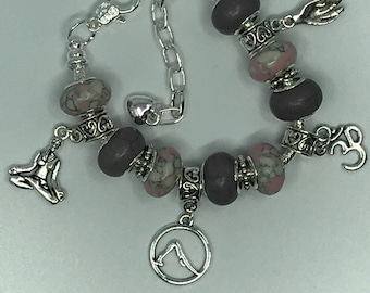 Yoga and meditation themed charm bracelet in pink and grey