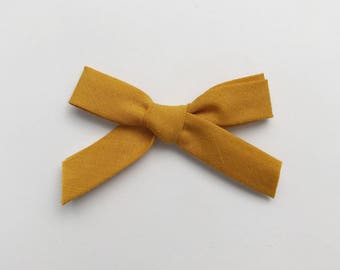 Bow tie on headband or hair clip - baby girl and boy - bias - ocher