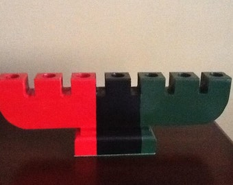 Red, Black and Green Wooden  Kinara for Kwanzaa.