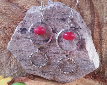 Red dyed jade with antique silver rings