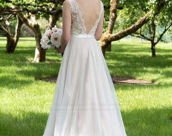 Lace wedding dress in nude color, sleevelss V-back alencon lace with tulle skirt.