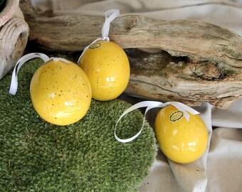 Easter egg made of ceramic, ceramic jewelry, art decor, citrus yellow