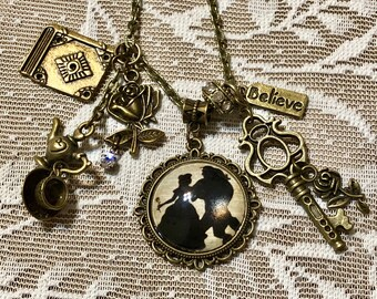 Beauty And The Beast, Pendant Charm Necklace.  In Antique Bronze Tone.