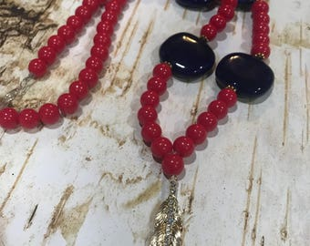 Red and dark blue beades becklace with gold leaf pendant