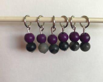 Purple and black stitch markers