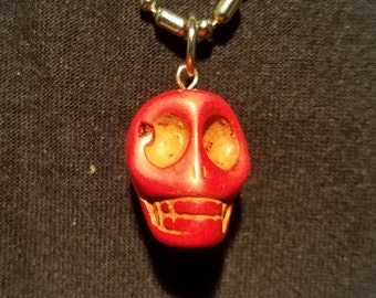 Red With Gold Highlights Stone Skull Necklace