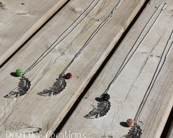 Feather necklace with sparkle ball