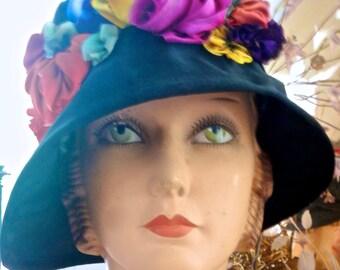 a Libby Brighton creation circa 1990 in a silk cloche style hat.