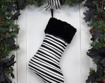 Black and White Horizontal Stripe Christmas Stocking with Black Faux Fur