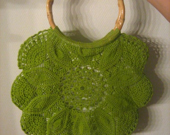 Crocheted green bag with bamboo handles