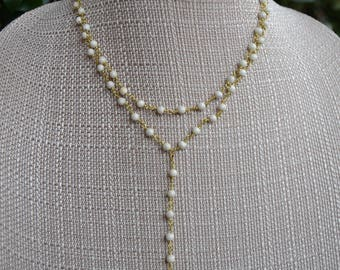 Double Strand Y Necklace with San Benito Cross Medal