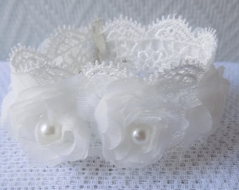 Wedding ceremony bracelet in white lace, organza, pearls flowers.