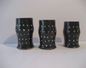 Set of three small handmade ceramic vases or cups