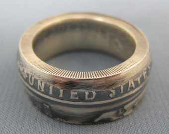 Coinring or muntring made of a dollar 1984 olympic games U.S.A.