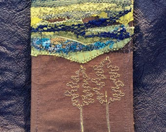 hand bound textile journal - note book- spell book. freemotion embroidery fabric collage appliqué landscape fiber arts book recycled paper