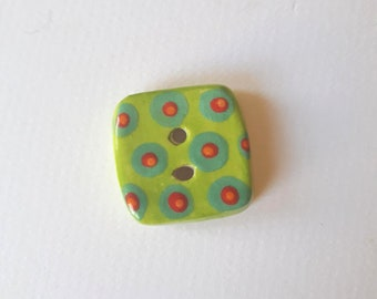 Square ceramic button