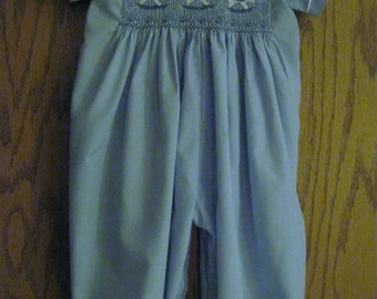 hand smocked romper with rocking horses