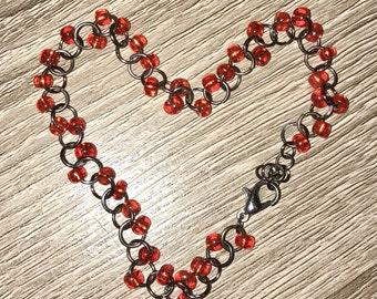 Red and gunmetal beaded bracelet