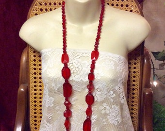 Vintage 1960's faceted red scrylic beads long necklace .