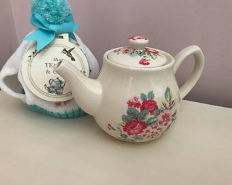 Small tea pot and cosy