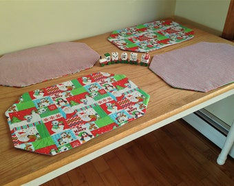 Christmas Placemats! Set of Four Reversible Mats Featuring Santa, Polar Bears and Penguins in Reds and Greens!
