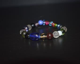 Dark Colored Bracelet With A Hint of Pink and Blue