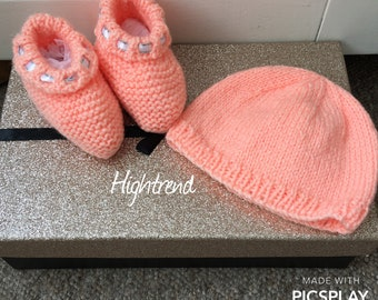 Hand knitted baby hat and booties
