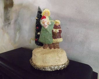 Vintage Teena Flanner Mother And Child With Brush Tree_Sparkle Christmas Decor Mother And Girl with Brush Tree And Tinsel 1980s