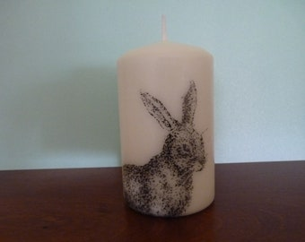 4 inch pillar candle with hare decoration