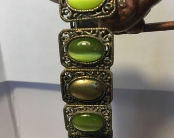 vintage green colored and gold bracelet, medieval design