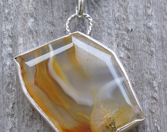 Agate free form cut pendant in sterling silver