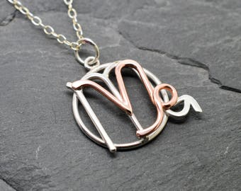 Scorpio Capricorn necklace sterling silver and polished copper