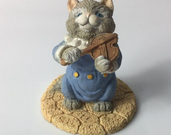 Ceramic beautiful cat playing with violin