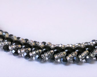 Black flat spiral bracelet/Handmade with stone beads, faceted and silver colour seed beads/Elegant sparkly jewellery/Love heart toggle clasp