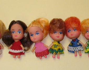 6 Tiny Dolls Charms as shown in picture