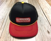 "Infant/Toddler Trucker Hat with ""Feminist"" Pa..."
