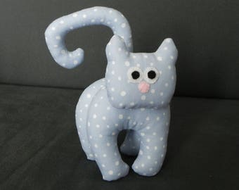 little blue cat with white polka dots