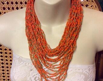 Vintage 1950's orange and gold multi strand micro beads bib necklace.