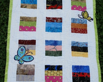 Colorful Scrap Wall Quilt with Appliqud Butterflies pieced and machine quilted by Barb Lynn