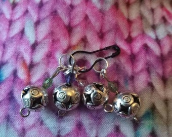 Set of four Tibetan silver sock stitch markers.