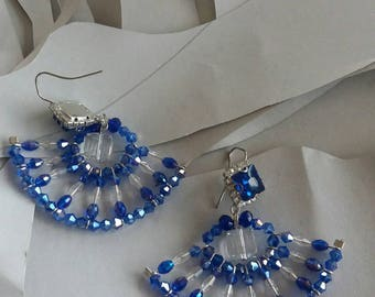 Hand-made two-coloured fan shape earrings.