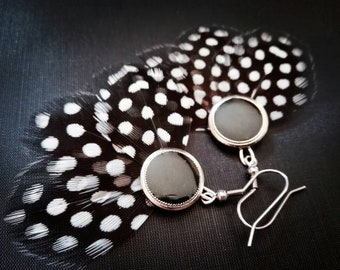 Guinea fowl feather earrings.